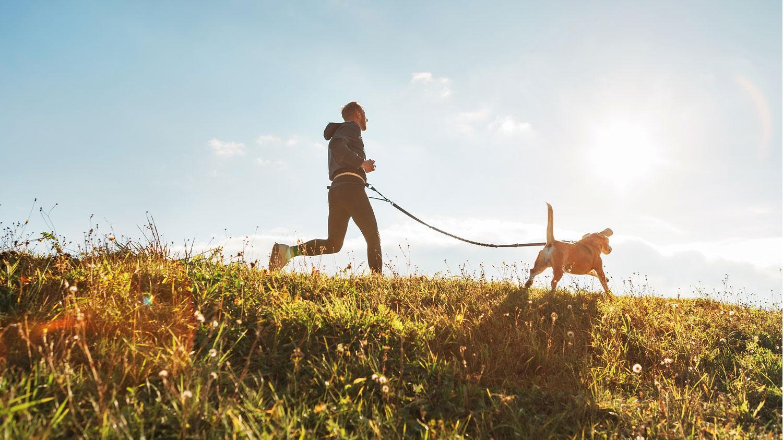 Man Running With Dog