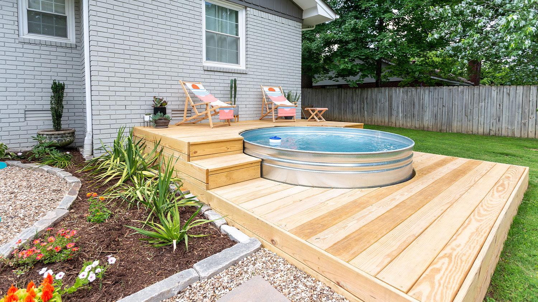 Stock tank hot tub on wood deck