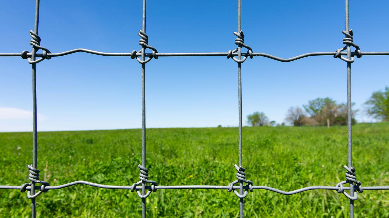 Metal Wir Fence Across Farm